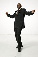 Man wearing suit, dancing