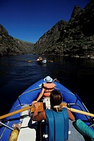 Mother with daughter (12-13) paddling down Salmon River, Idaho, USA, elevated view