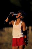 Roller-skater drinking water from bottle