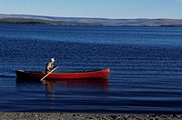 Man canoeing in lake