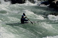 Man kayaking in rapids of Skykomish River, Washington, USA, elevated view