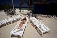 Asian woman laying on beach chair, elevated view