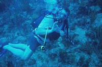 Man scuba diving, giving ´okay´ sign, underwater viewpoint