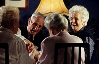 Elderly group playing cards