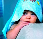 Baby boy wrapped in a towel after bath (thumbnail)