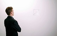 Businessman studying the line graph.