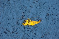 Mountain rescue. RAF rescue helicopter during an operation in the Cairngorms mountain range. Photographed in Cairngorms National Park, Scotland, in No...