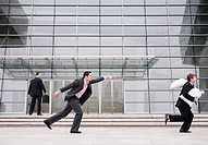 Businessman chasing after a thief (thumbnail)
