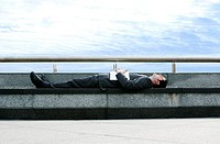 Businessman sleeping on the bench (thumbnail)
