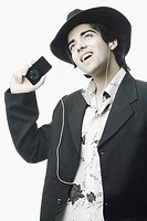 Close-up of a young man listening to an MP3 player