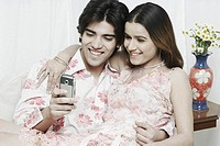 Close-up of a young couple looking at a mobile phone