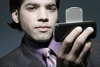 Portrait of a businessman holding a mobile phone
