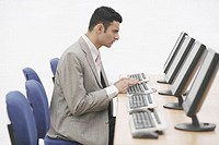 Side profile of a businessman sitting in front of a computer