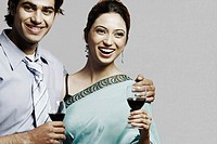 Portrait of a young couple holding wineglasses