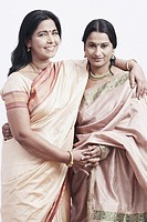 Portrait of a mature woman standing with a mid adult woman (thumbnail)