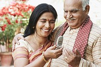Close-up of a mature couple looking at a mobile phone