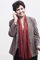Portrait of a mature woman talking on a mobile phone (thumbnail)