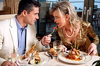 Mature couple dining in a restaurant (thumbnail)