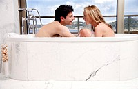 Couple enjoying bubble bath together (thumbnail)