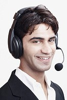 Portrait of a young man wearing a headset
