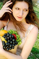 Woman holding a bag of fruits (thumbnail)