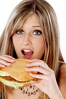 Woman about to bite on a burger
