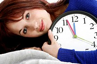 Woman hugging a clock