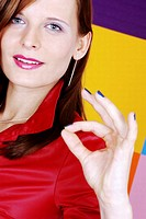 Woman showing an OK sign
