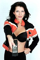Woman in bra and jacket using remote control