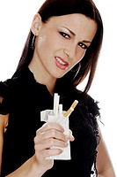 Woman crushing a box of cigarettes