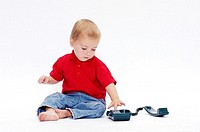 Boy playing with telephone
