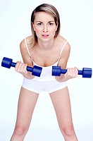 Woman lifting two dumbbells