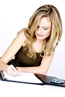 Businesswoman writing report (thumbnail)