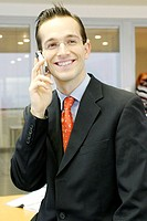 Businessman talking on the mobile phone (thumbnail)