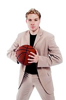 Businessman holding a basketball