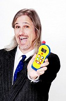 Businessman holding a toy mobile phone
