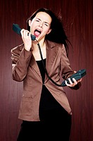 Businesswoman screaming into the phone.