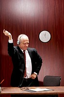 Businessman dancing while listening to music on the headphones
