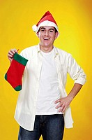 Man in christmas hat holding a christmas sock
