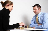 Business people playing chess game