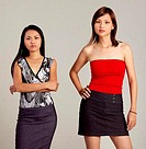 Studio shot of two women posing for the camera