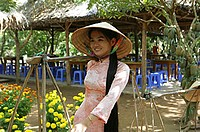 A Vietnamese woman in national costume, Cu Lao Thai Son Island, Vietnam