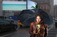 Female pedestrian with umbrella