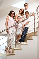 Family standing on stairs (thumbnail)