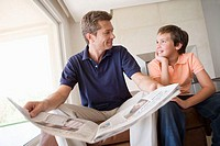 Son and father with newspaper