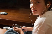 Boy listening to MP3 player