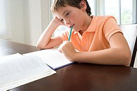 Boy bored with homework