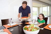 Father bringing meal to table