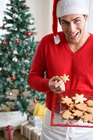 Man with festive biscuits