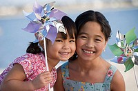 Sisters with pinwheels